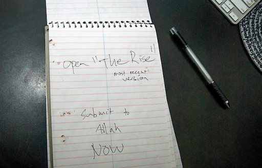 "Police released this photo of a spiral notebook found in an office in the Crowley home, open to a page with dried blood on it and the handwritten words, ""Submit to Allah NOW."" Photo courtesy of the Apple Valley Police Department."
